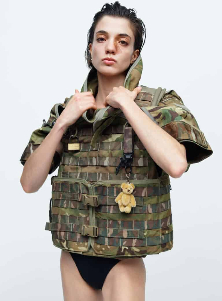 MODEL-DAIRA-DA-SILVA-PINTO-WEARING-BRITISH-ARMY-CAMOFLAUGE-OSPREY-MK4-BODY-ARMOR-CIRCA-2010-MINI-TEDDY-BEAR-KEYRING-STEIFF-BLACK-ONE-PIECE-SWIMSUIT-SPEEDO-PHOTOGRAPHY-JOHN-GUERRERO-STYLING-WILLIAM-BARNES-HAIR-ALFIE-SACKETT-MAKEUP-LUCY-BURT