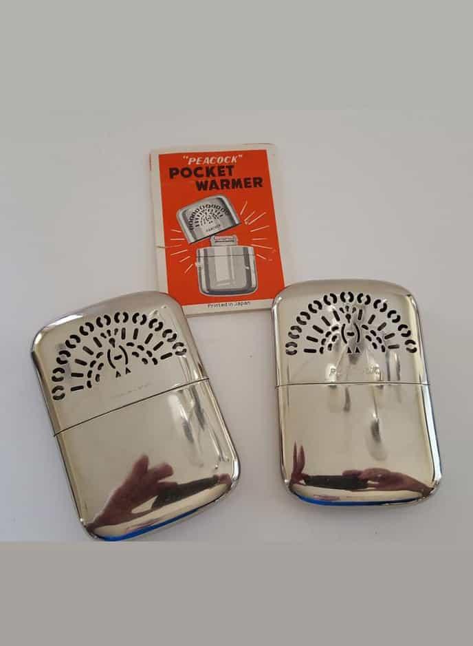 Vintage pair 1960's Peacock brand pocket warmers with original brochure